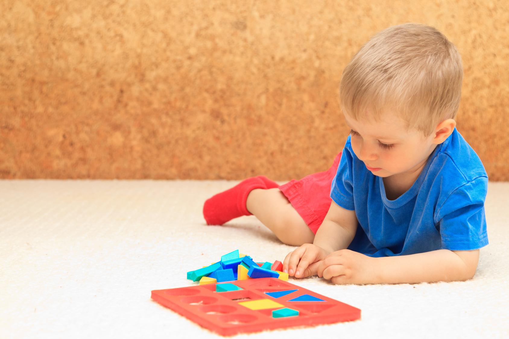 little boy learning shapes